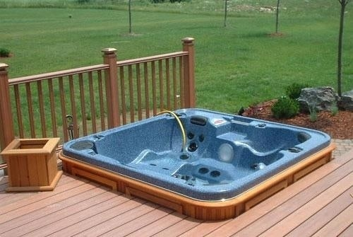 arctic spas hot tub in deck corner