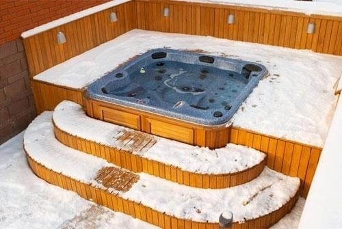 arctic spas hot tub in deck with snow