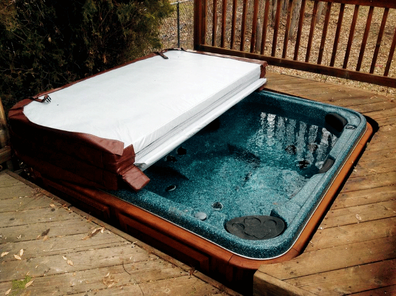Half covered Arctic Spas Hot tub build in a deck