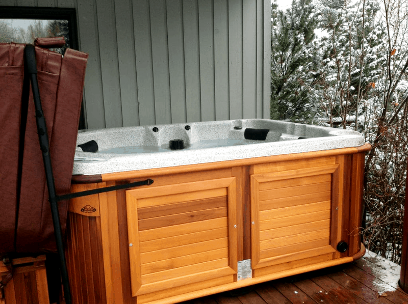 Arctic Spas Hot tub on a deck in winter